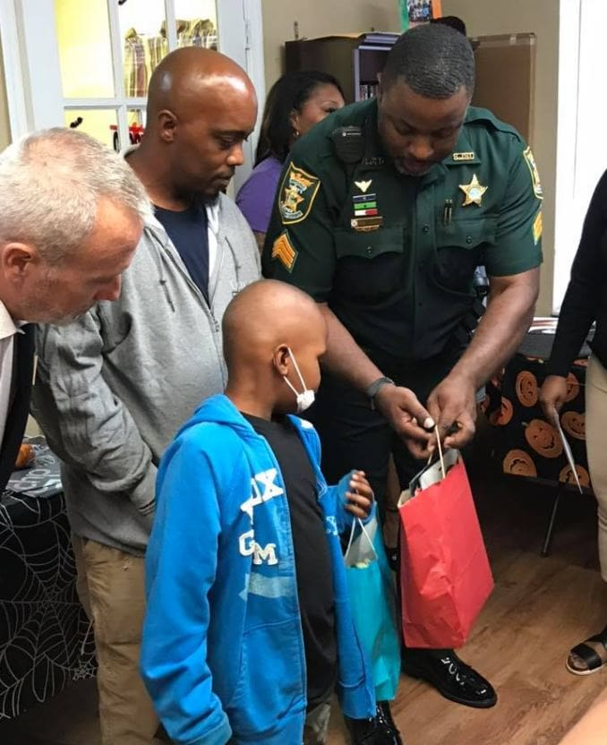 Florida sheriff surprises 7-year-old boy battling cancer with an all expenses paid, dream trip to Disney World