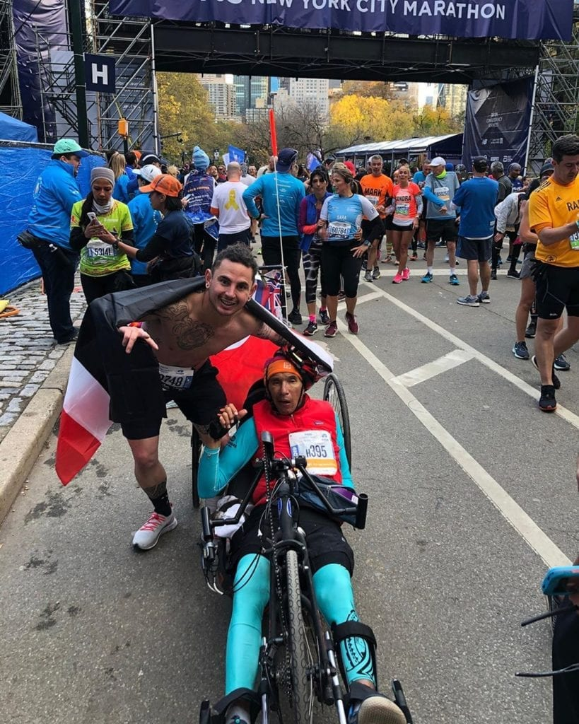 Runner who flew from New Zealand for the NYC Marathon stops halfway to help disabled racer cross the finish line