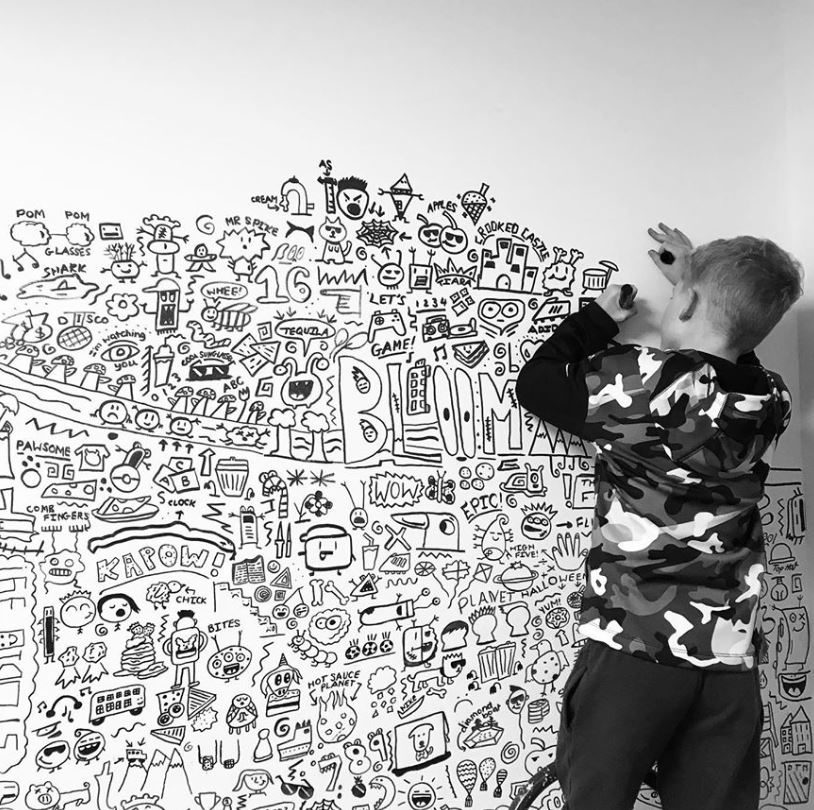 9-year-old boy kept getting in trouble for doodling at school, then a local restaurant hired him to decorate their walls.