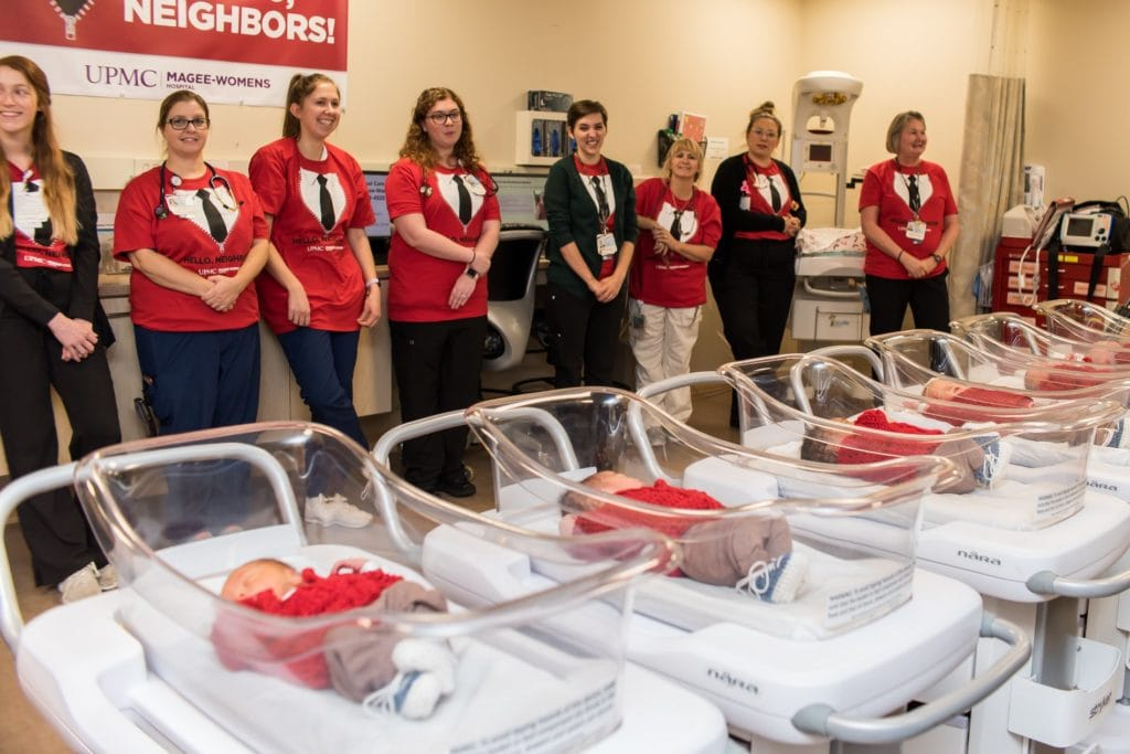 New born babies at Pittsburgh hospital wear red cardigans to honor Mr. Rogers on World Kindness Day.