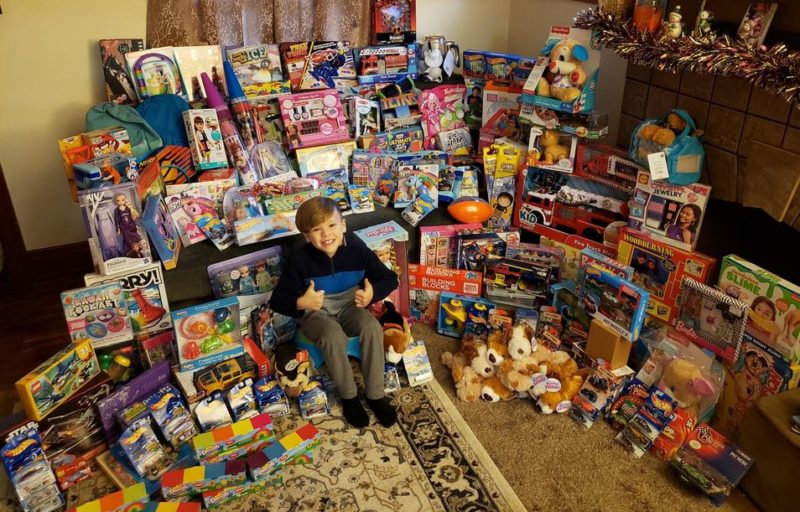 Boy who created homemade flyer asking for holiday donations ends up collecting 165 gifts for children in need.