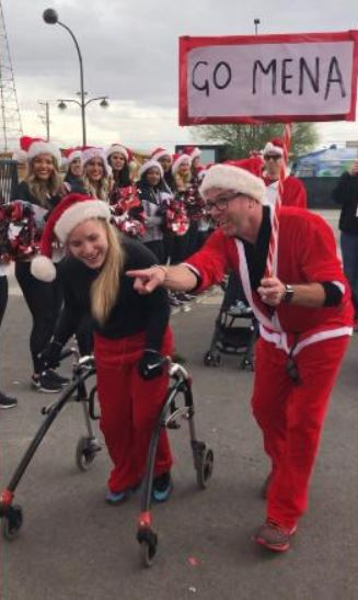 Girl with cerebral palsy overcomes the odds to finish annual Santa Run in record time using a walker.