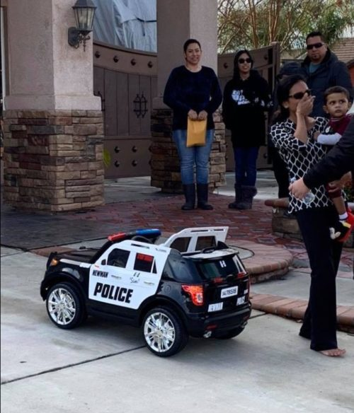 Police department visits son of fallen officer to deliver special gift of little squad car modeled after his daddy's.