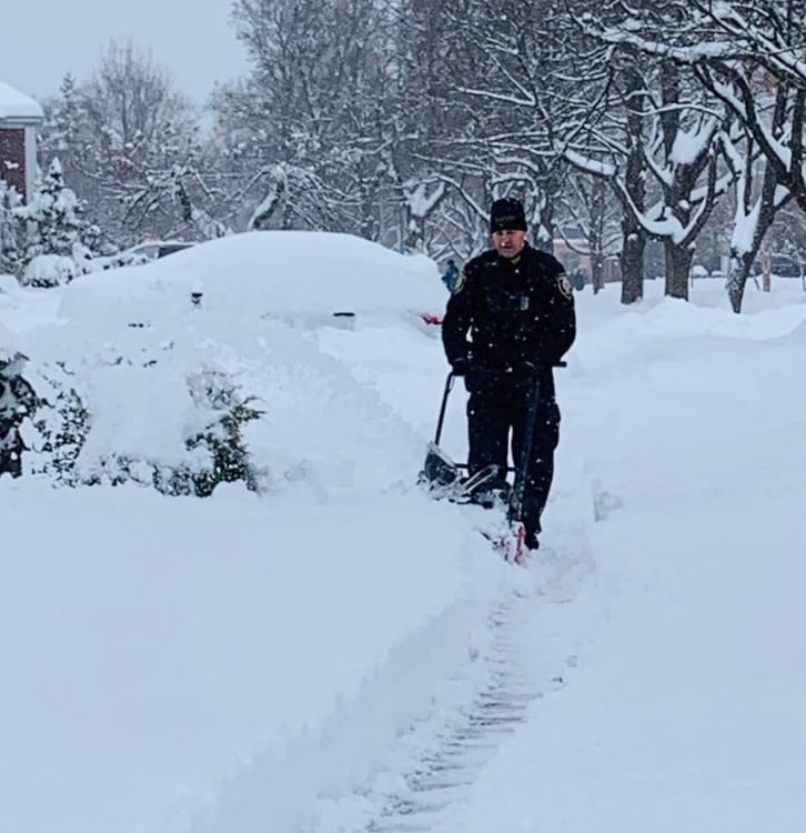 A trio of compassionate police officers shovel 12 inches of snow for a 99-year-old woman who lives alone.