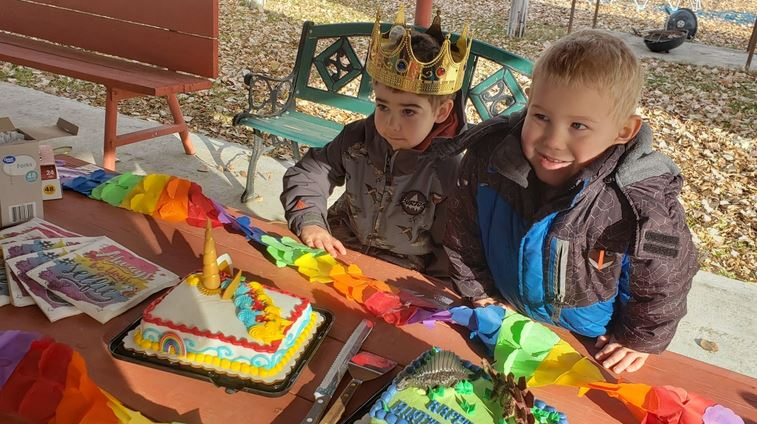 Wyatt Haas, 5, and his brother Asher, 4, wait anxiously to cut into the unicorn cake at Wyatt's send-off party.