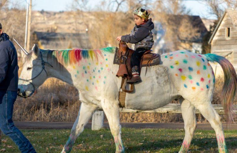 Wyatt Haas enjoys a unicorn ride on Bonanza, owned by Will and Jennifer Nielsen of Fallon, Mont.