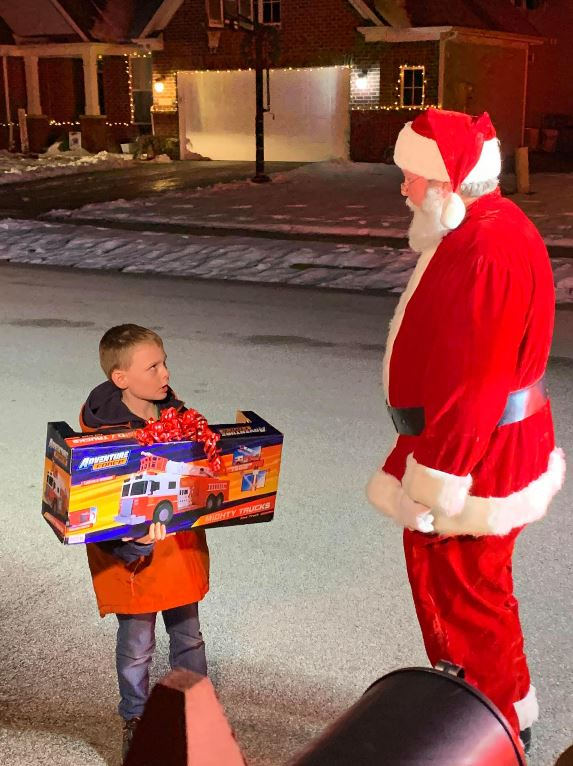 Santa makes special visit on firetruck to boy with autism after he was turned away at local mall for having his service dog.
