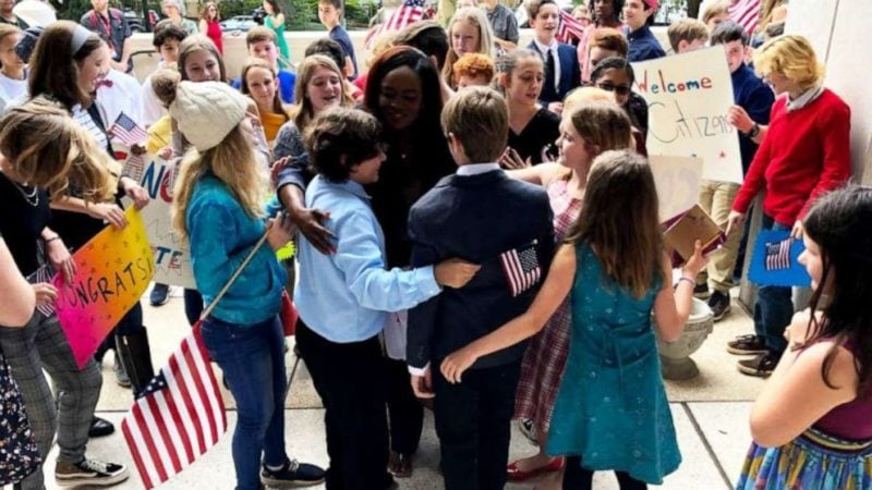 Hardworking teacher celebrates with her students after taking the oath to become a U.S. citizen.