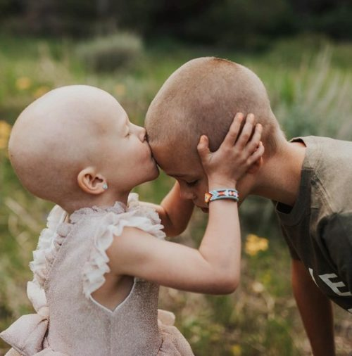 After chemo took her hair, family lets little girl battling cancer shave their heads to show they're all in it together.