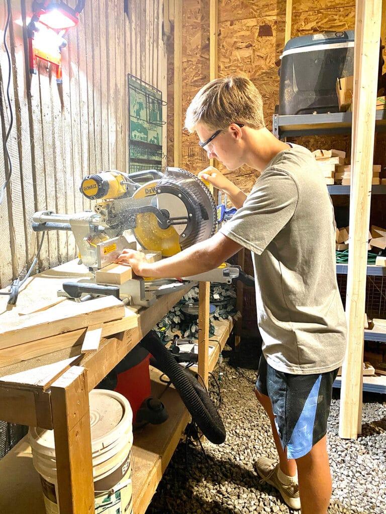 Colby building desks for underprivileged kids.