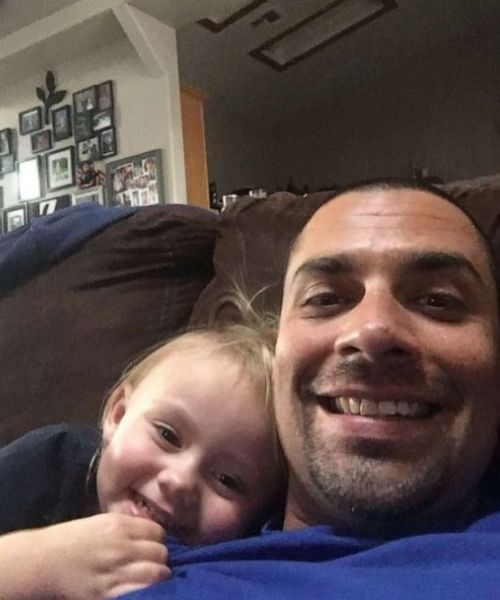 Officer Brian Zach and Kaila hanging out at home.