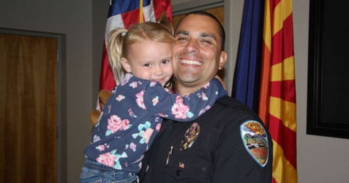 Arizona police officer adopts little girl he connected with while on child abuse call.